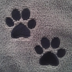 Embroidered paw prints on DryPet Towel