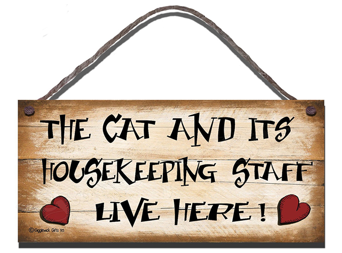 funny cat sign that says the cat and its housekeeping staff live here