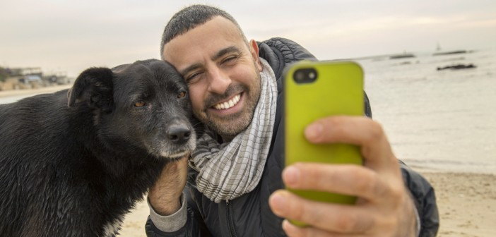 man and dog taking a selfie for social media