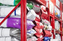 bags of commercial dog food on store shelves