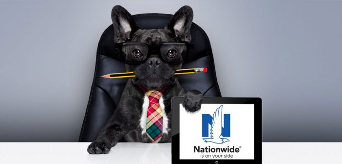 dog behind a desk holding a tablet with the nationwide logo