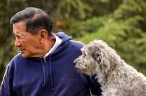 older man with his older dog