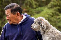 older man with his older dog